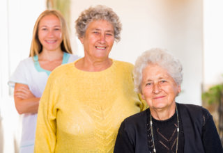 caregiver and elders showing their genuine smile
